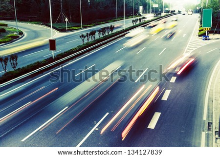 Highway with lots of cars. Blue tint, high contrast and motion blur to rise speed. #134127839