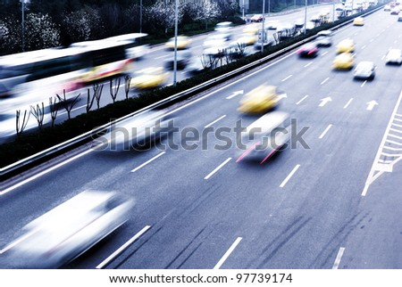 Highway with lots of cars. Blue tint, high contrast and motion blur to rise speed. #97739174