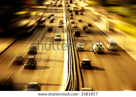 Highway with lots of cars. Red sunset light, high contrast and motion blur to rise speed.