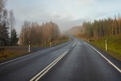 Highway without cars. fog in the distance. Autumn day. in Finland .