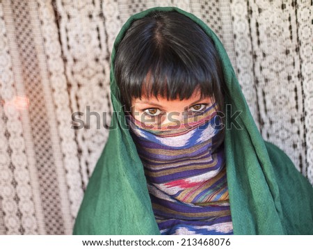 Hijab Portrait of young girl covers her face with a veil
