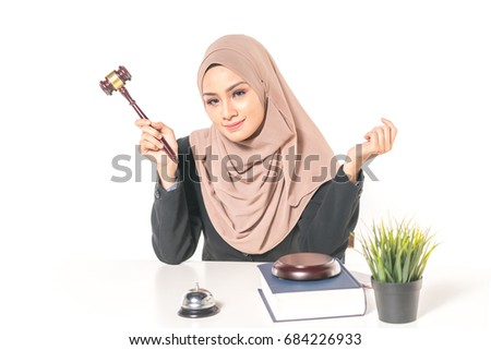 Hijab woman with gavel and hammer. Law concept.