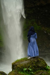 hijab women are enjoying splashing waterfalls