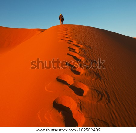 Hike in Namib desert - stock photo