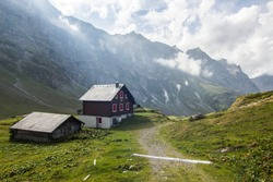 Hike in Swiss Alps with nature views; shepherd's house in mountains; cable car station; chalet