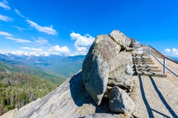 Hike on Moro Rock Staircase toward mountain top, granite dome rock formation in Sequoia National Park, Sierra Nevada mountains, California, USA