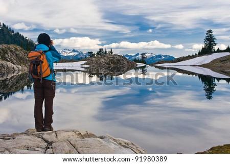 Hiker at Lake Ann, Mt Baker, Washington