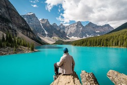 Hiker at Moraine Lake during summer in Banff National Park, Alberta, Canada.