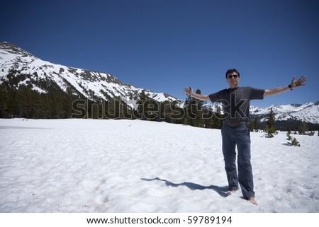 Hiker at Snowy Tioga Pass in Yosemite National Park - stock photo