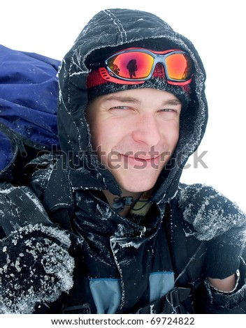 Hiker at the mountains covered with snow