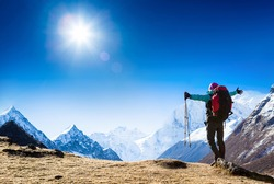 hiker at the top with backpack enjoy sunny day