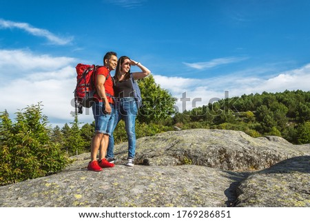 Hiker couple on the mountain looking at the horizon