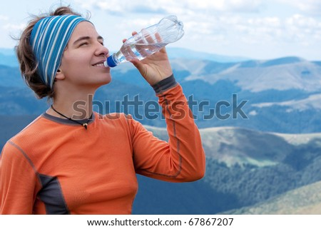 Hiker drinks