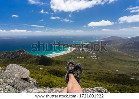 Hiker enjoying the view from the summit of Mount Oberon at Wilsons Promontory National Park at Victoria, Australia