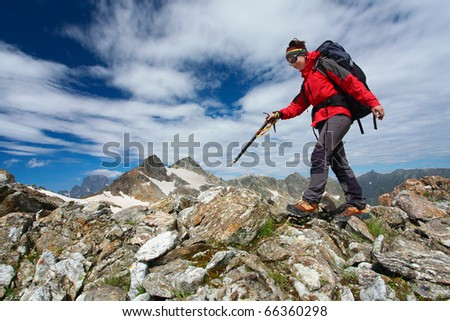 Hiker girl in Caucasus mountains