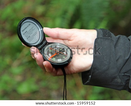 Hiker holding a Compass in their Hand