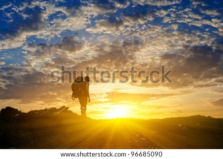 hiker in a mountains at the sunset #96685090