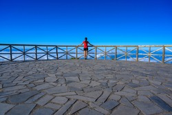 Hiker in Madeira Island - View Point of mountain scenery of the highland - tabove the clouds - ravel destination for outdoor sports - Portugal