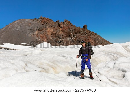 hiker in the mountain. Climb to the top. mountaineering