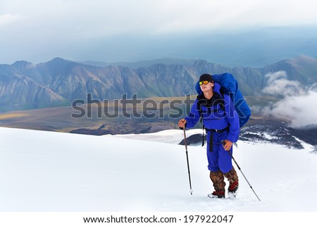 hiker in the mountain. Climb to the top. summer hiking