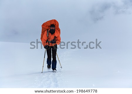 hiker in the mountain. Climb to the top. winter hiking
