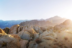 Hiker in unusual stone formations in Alabama hills, California, USA