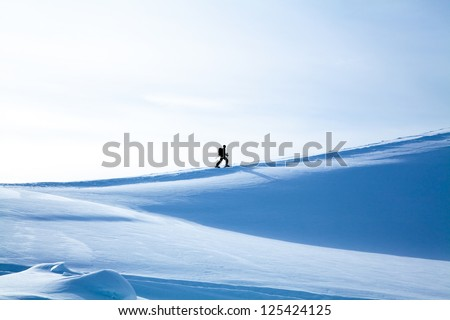 Hiker in winter mountains. Winter landscape. winter mountains landscape. Beautiful winter