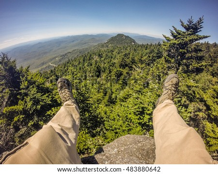 Hiker legs and boots view on the mountain peak relaxing outdoor mountain sport Stock fotó ©
