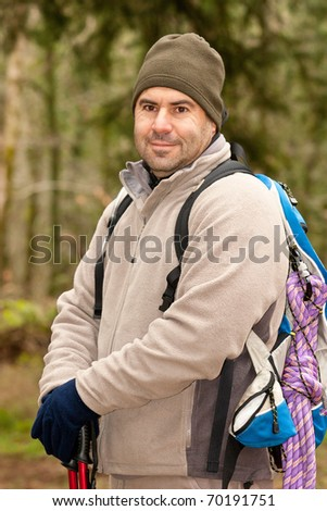 hiker looking on front of him with backpack and gear