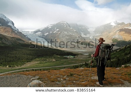 Hiker Looking Out Over Columbia Icefield - Jasper National Park, Alberta, Canada