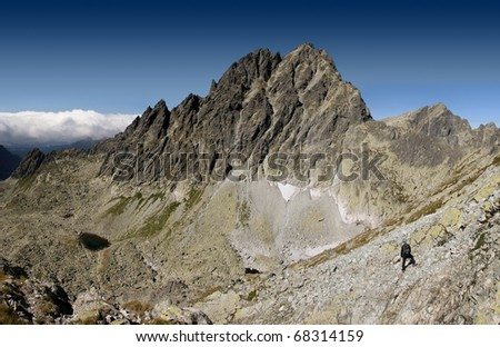 Hiker looks at a high peak. Vysoka in the Tatra Mountains.