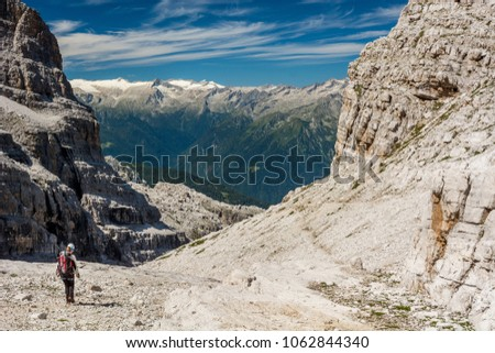 Hiker on a mountain trail. #1062844340