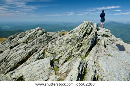 Hiker on Camels Hump in Vermont, which is part of the Long Trail.