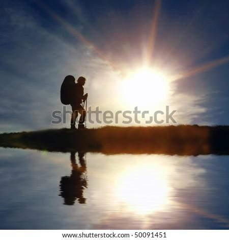 hiker on sunset background