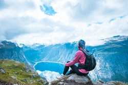 Hiker on the mountain top. Sport and active life concept. Trolltunga Norway