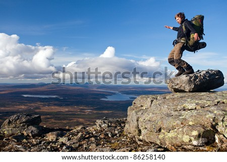 Hiker on the Top of the Mountain without balance