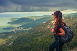 Hiker on top of a mountain. Achievement in mountains. Freedom and active life concept.
