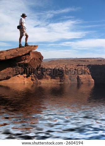 Hiker Overlooking Colorado river in Grand Canyon