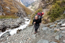 Hiker relaxing at mountains, Tien Shan, central asia, Kyrgyzstan. Climbing and mountaineering concept.