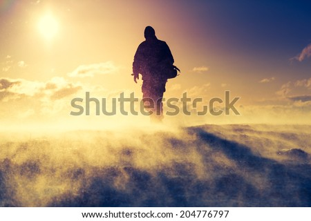 Hiker standing on top of a mountain. Dramatic scenery. Carpathian, Ukraine, Europe. Beauty world.