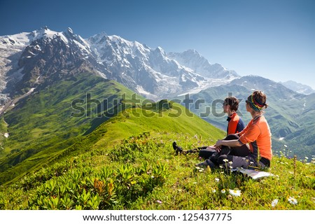 Hiker take a rest during hiking in Caucasus mountains, Georgia