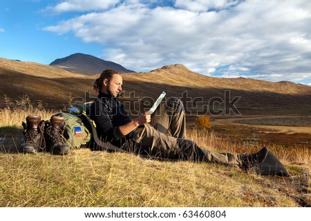 Hiker takes a break in the evening sun
