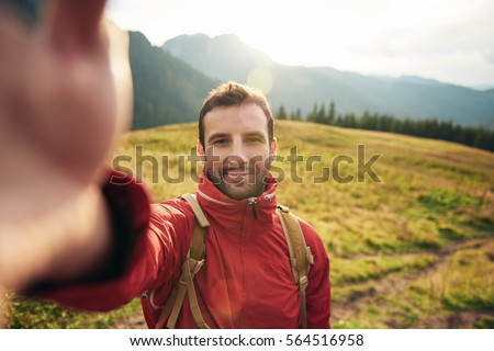 Hiker taking a selfie while out trekking in the wilderness #564516958