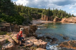 hiker taking in the views in Acadia National Park