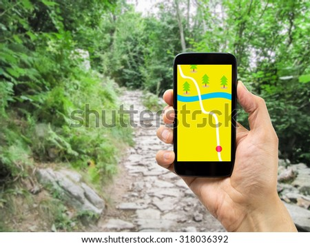 hiker using smart phone gps on travel hike living healthy active. #318036392