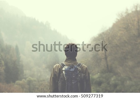Shutterstock hiker walking in a mystic forest