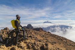Hiker watches Volcano Popocatepetl erupt trekking in at the top Iztaccihuatl volcano, Mexico, Iztaccihuatl Popocatepetl National Park
