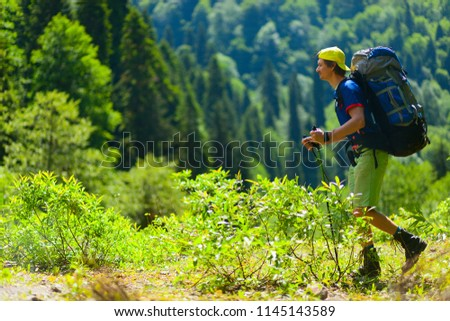 Hiker with big backpacks walking in the mountains. - Shutterstock ID 1145143589