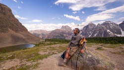 Hiker with dog at the top of ten peaks trail in Jasper National park, Alberta, Canada