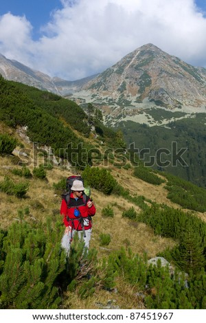 hiker with GPS at Retezat Mountains, Southern Carpathians, Romania